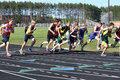 Teen Boys Starting a Long Distance Tack Meet Race Royalty Free Stock Photography