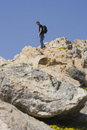 Teen climbing a mountain Royalty Free Stock Photos
