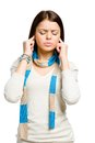 Teen closes her ears with hands eyes closed isolated on white Stock Image