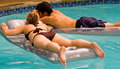 Teen couple floating in pool Royalty Free Stock Image