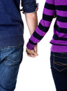 Teen couple holding hands Stock Images
