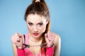 Teen crime teenager girl handcuffs studio shot blue background Stock Images