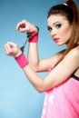 Teen crime teenager girl handcuffs studio shot blue background Royalty Free Stock Photos