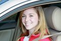 Teen driver in car female sitting with seat belt on and smiling Stock Image