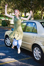 Teen Driver Jumping for Joy Royalty Free Stock Image