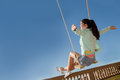 Teen freedom girl on swing in summer Royalty Free Stock Images
