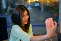 Teen friends taking photos portrait of beautiful thai girl in action with a smartphone Stock Image