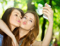 Teen friends taking photos with a smartphone selfie Royalty Free Stock Image