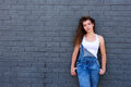 Teen girl with attitude standing with hands in pockets Royalty Free Stock Photo