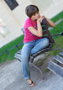 Teen girl on the bench Royalty Free Stock Photo