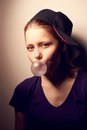 Teen girl blowing bubble cute nice Royalty Free Stock Image