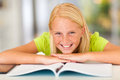 Teen girl book happy lying on at home Stock Photography