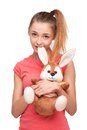 Teen girl with bunny toy beautiful looking at camera isolated on white background Royalty Free Stock Images