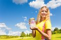 Teen girl with butterfly jar happy blond holding glass standing in the park on sunny summer day Stock Photo