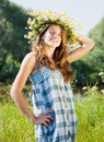 Teen girl  in camomiles chaplet Royalty Free Stock Photos