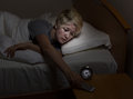 Teen girl checking cell phone late at night while in bed Royalty Free Stock Photo