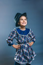 Teen girl child in a plaid dress and men's hat Royalty Free Stock Photo