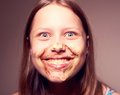 Teen girl with chocolate on her face cute happy having fun Royalty Free Stock Image