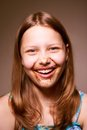 Teen girl with chocolate on her face cute happy having fun Royalty Free Stock Photos