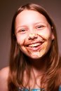 Teen girl with chocolate on her face cute happy having fun Royalty Free Stock Photo