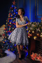 Teen girl in Christmas at the beautiful Christmas tree g Royalty Free Stock Photo