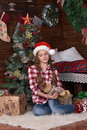 Teen girl in a Christmas hat and plaid shirt Royalty Free Stock Photo