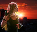 Teen girl in city looking sunset Royalty Free Stock Photo