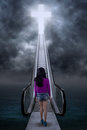 Teen girl climb a stairway to the cross Royalty Free Stock Photo
