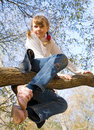 Teen girl climbing on the tree Royalty Free Stock Photo