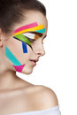 Teen girl with colored stripes on the face. Bright make-up art. Royalty Free Stock Photo