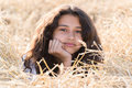 Teen girl with curly dark hair on nature a Stock Photography
