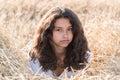 Teen Girl With Curly Dark Hair...