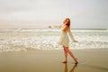Teen girl dancing at the beach Royalty Free Stock Photo