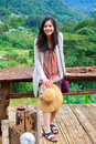 Teen girl on decking on mountainside biracial green of thailand Stock Photo