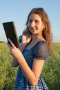 Teen girl with electronic book reader Royalty Free Stock Images