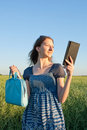 Teen girl with electronic book reader Royalty Free Stock Photos