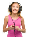 Teen girl enjoying music using headphones closeup portrait of lovely isolated over white Stock Photo