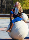 Teen girl fall boots in fashion blue jeans infinity scarf and printed shirt Royalty Free Stock Photos