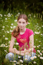 Teen girl in a field of daisies Stock Photos