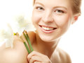 Teen girl with flower narcissus beautiful smiling and and looking at camera Stock Photo