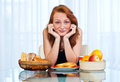 Teen girl with freckles at brakfast attractive red hair woman sitting the breakfast table her home Stock Photo
