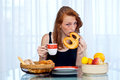 Teen girl with freckles at brakfast attractive red hair woman sitting the breakfast table her home Stock Image