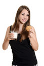 Teen girl with glas milk and oatmeal cookie isolated Royalty Free Stock Photography