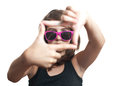 Teen girl with glasses make frame with her fingers Royalty Free Stock Photo