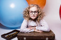 Teen girl in glasses with wooden abacus on the background of lar Royalty Free Stock Photo