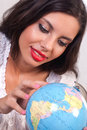 Teen girl with globe Royalty Free Stock Photography