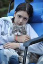 Teen girl with gray cat in her arms Royalty Free Stock Images