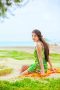Teen girl in green sundress at beach looking over shoulder Royalty Free Stock Photo