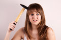 Teen girl with a hammer. Stock Image