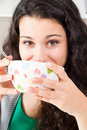 Teen girl having breakfast happy with beautiful brown eyes drinking from a bowl maybe milk or soup Stock Images